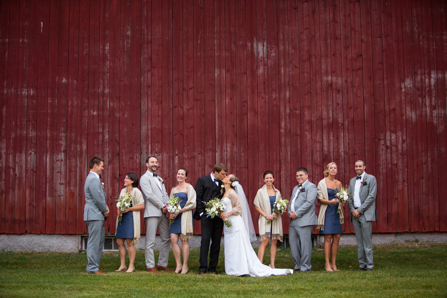 A wedding party group portrait at The Inn at Mountain View in Vermont by wedding photographer Stina Booth