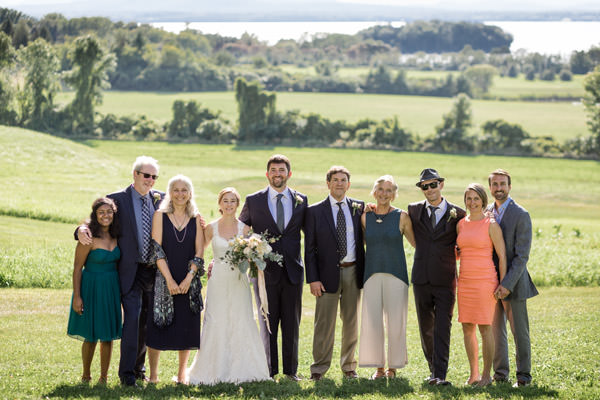 A family wedding group portrait at All Souls Interfaith Gathering in Vermont by wedding photographer Stina Booth