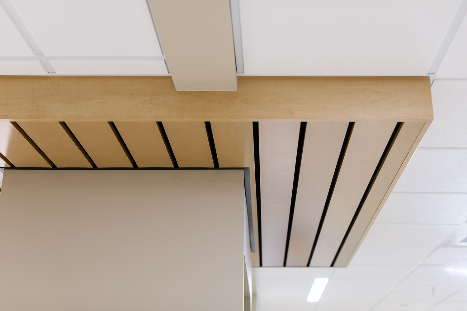 Detail photo of a ceiling wood bumpout in Northwestern Medical Center's Inpatient Progressive Care Unit in St. Albans Vermont constructed in 2017 photographed by Stina Booth of Studio SB.