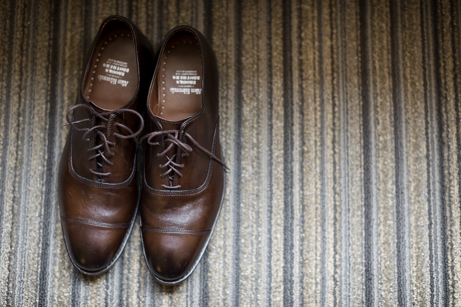 A photo of the groom's wedding shoes by wedding photographer Stina Booth of Vermont