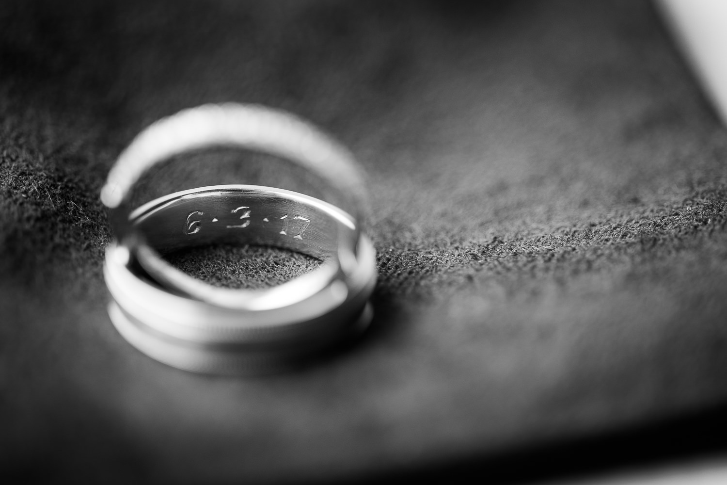 A detail photo of the couple's wedding bands at Jay Peak Resort by Stina Booth wedding photography Vermont