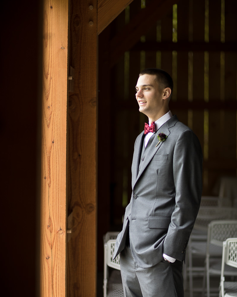 the groom waits before the first look at Jay Peak Resort by Stina Booth wedding photography Vermont, vermont wedding photographers