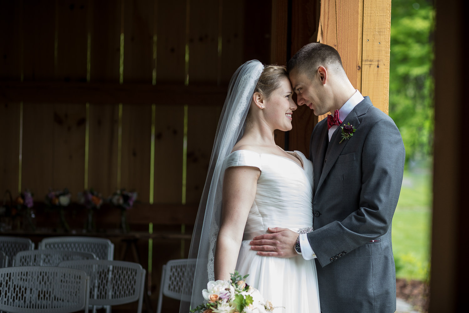 a couple's quiet moment during their wedding day first look in a photo by wedding photographer Stina Booth of Vermont