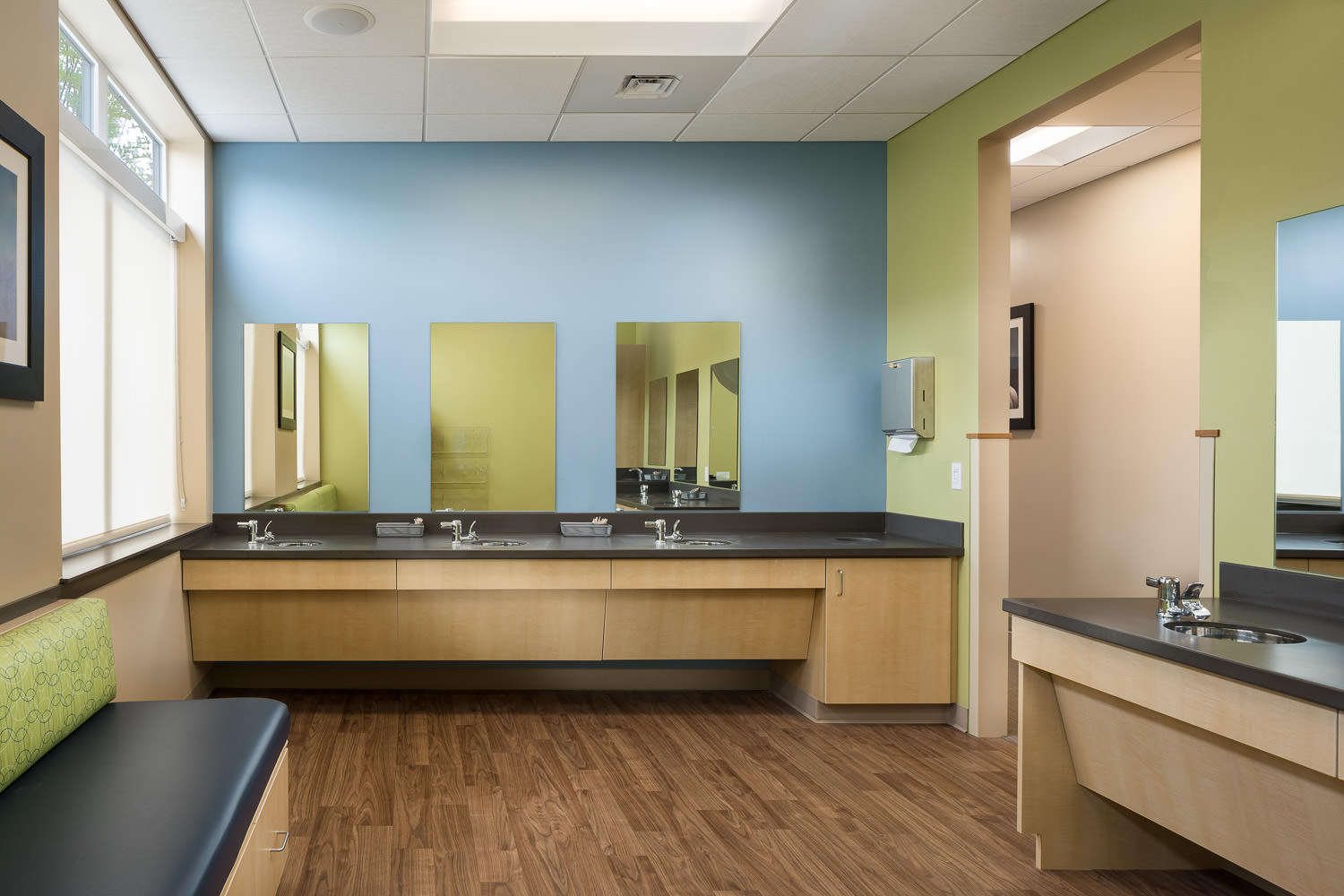 Dental office architecture photo of the kids brushing room in the new Timberlane Dental Office in Essex Vermont with interior design by BSD Interior Design and construction by Neagley & Chase photographed by Studio SB.