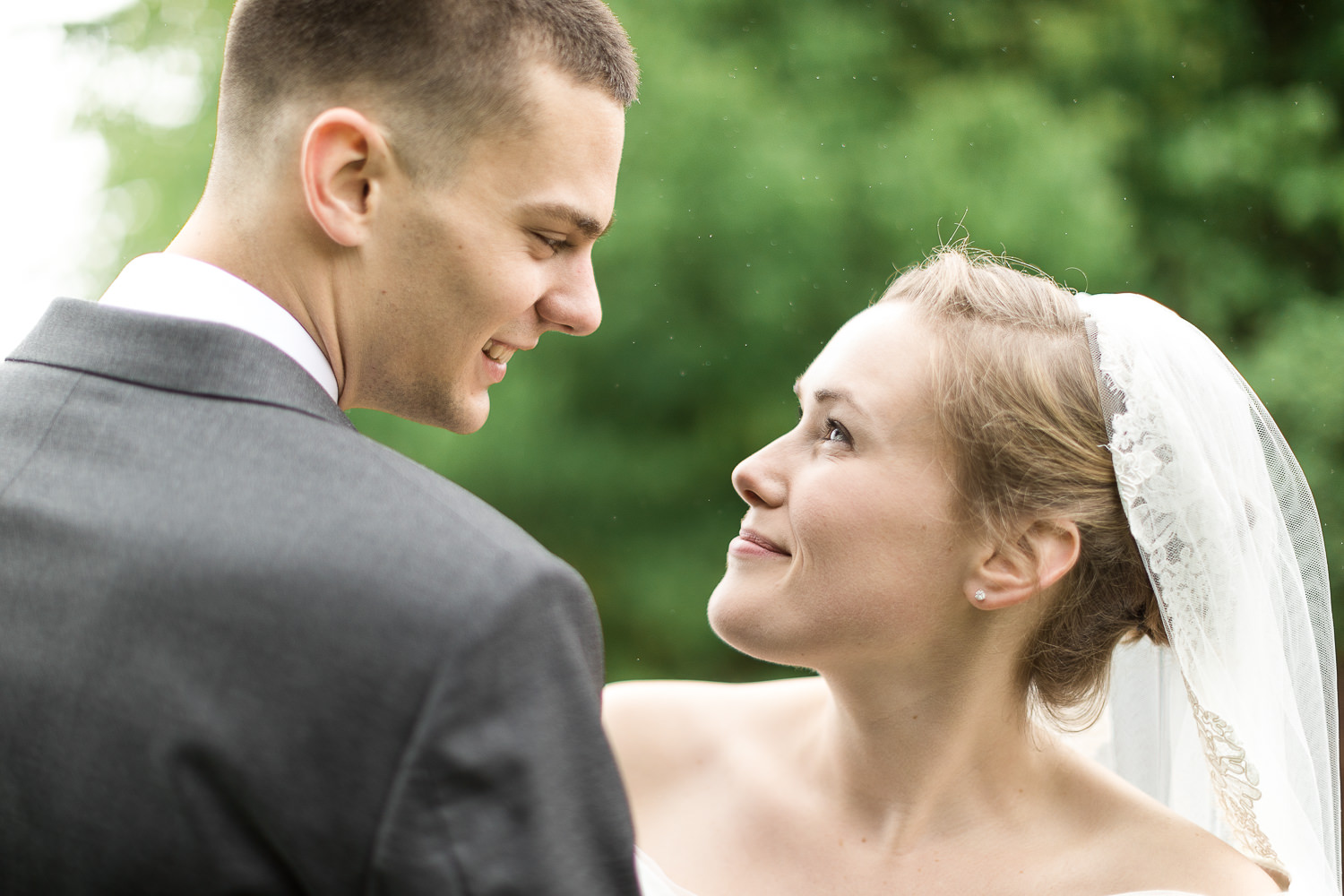A bride and groom look into each others eyes during their wedding day portrait session with Stina Booth Photographer at Jay Peak Resort