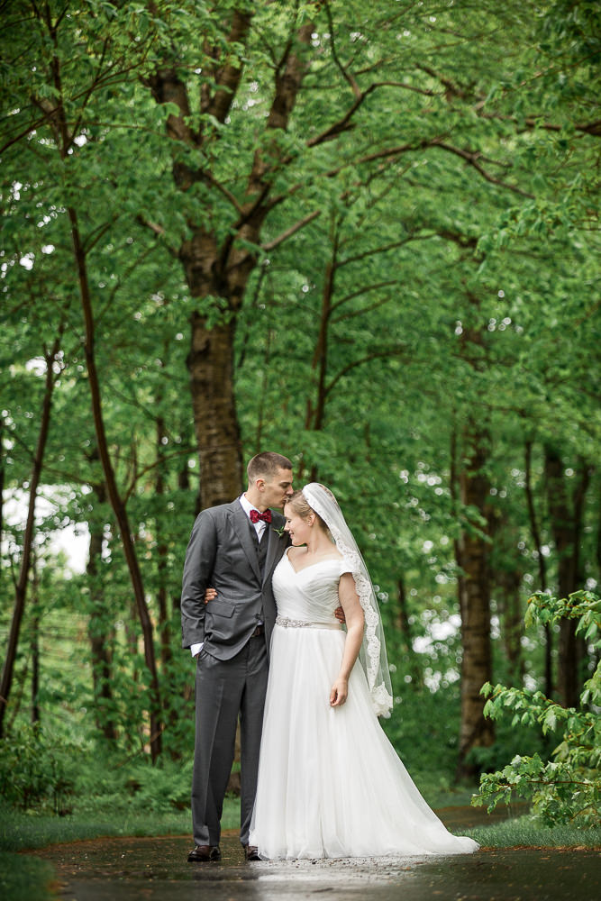 a wedding portrait of the couple in the woods at Jay Peak Resort