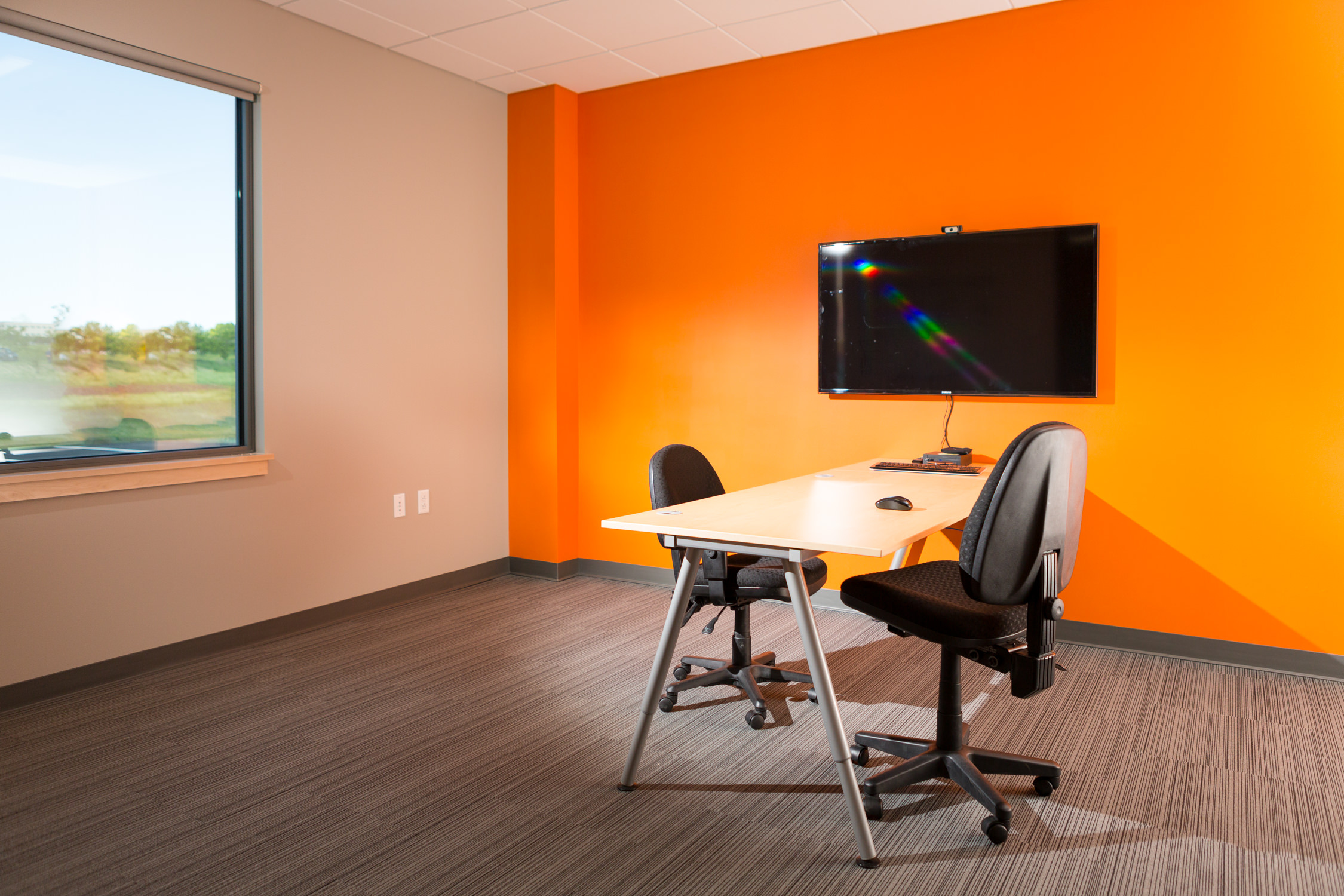 Photo of a small meeting room in the Logic Supply building addition for Neagley & Chase Construction Company by Vermont architecture photographer Stina Booth of Studio SB.