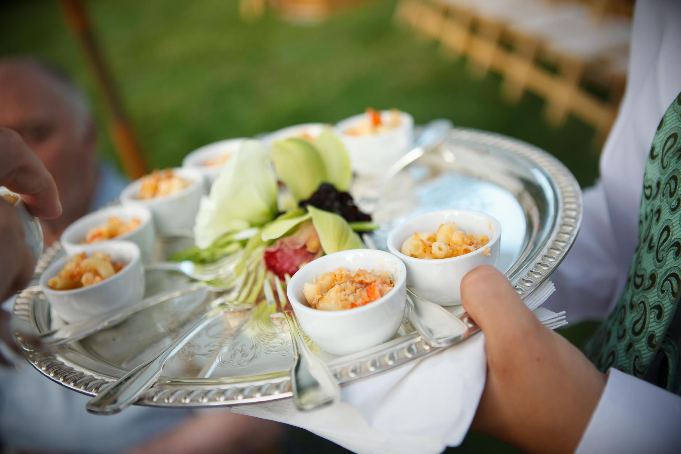 A photo of lobster mac and cheese hors d'oeuvres on a silver serving platter in a photo by Vermont food photographer Stina Booth