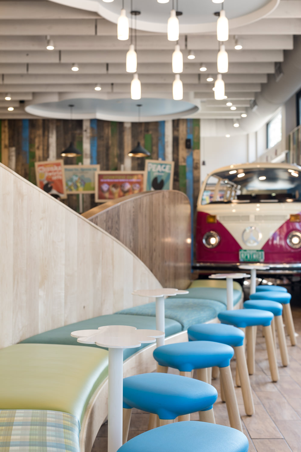 Photo of the colorful blue stools and green benches in the 2017 Ben & Jerry's scoop shop renovation on Church Street in Burlington Vermont by architecture photographer Stina Booth