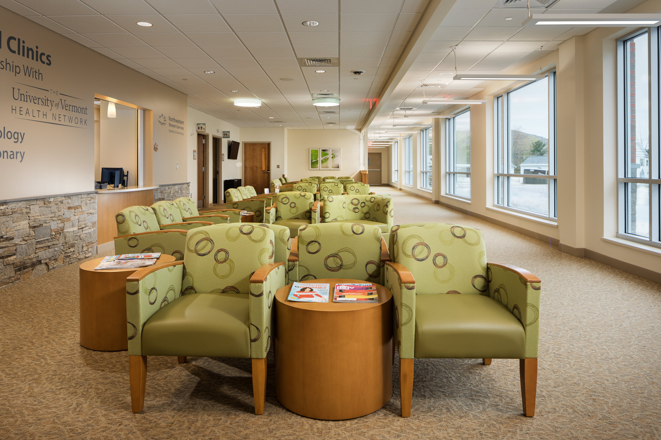 A view of the comfortable seating and expansive windows in the waiting area in Northwestern Medical Center's Clinics building in St. Albans by Vermont photographer Stina Booth