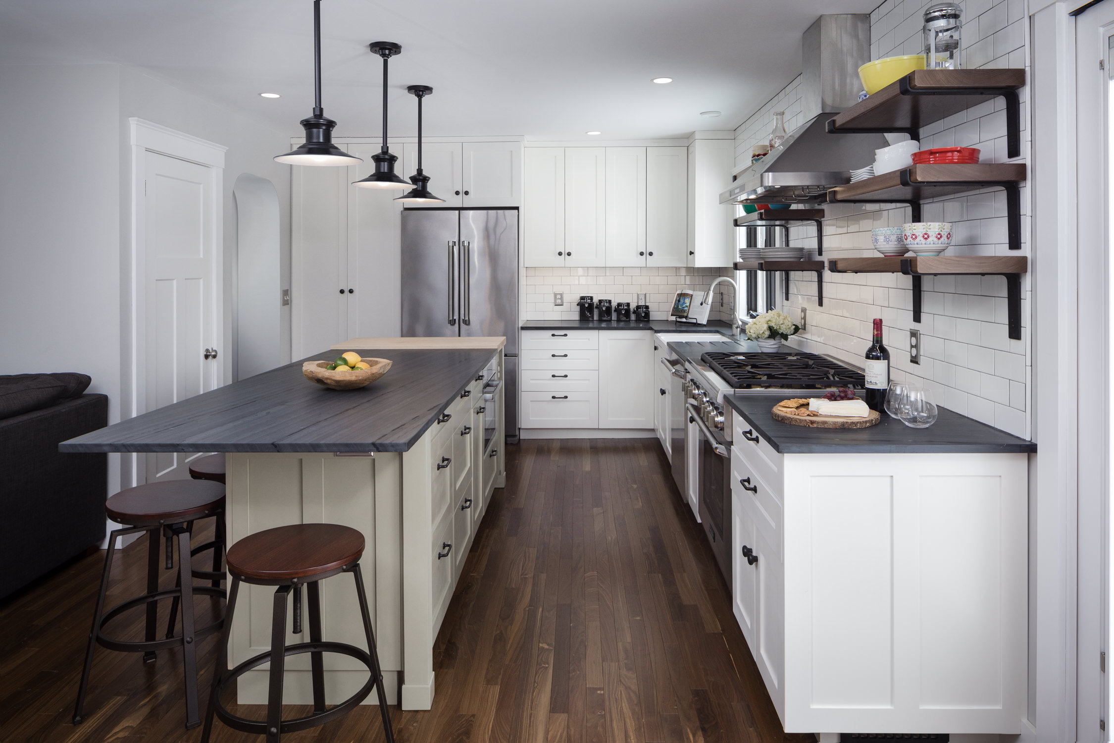 Photo of open plan kitchen by Stina Booth architecture photography of a Vermont kitchen remodel in Burlington by Roots Design Studio