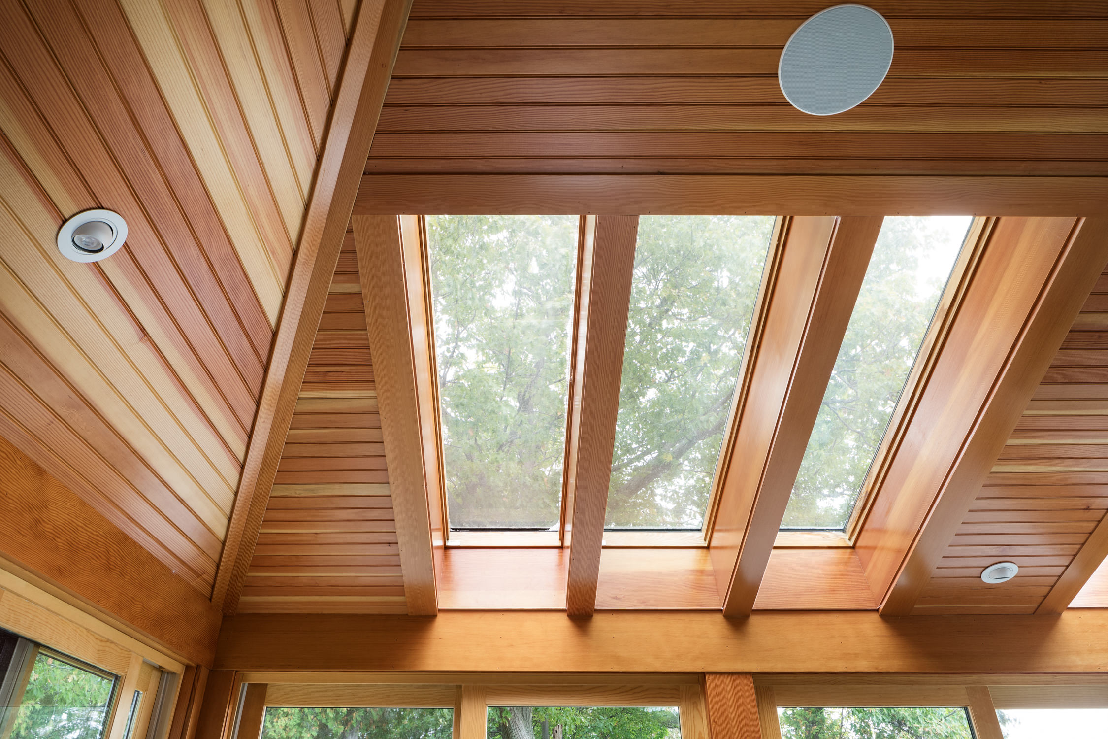 Photo of the wood paneled ceiling and skylights in a home renovation by Wiemann Lamphere Architects and photographed by Vermont photographer Stina Booth of Studio SB.,