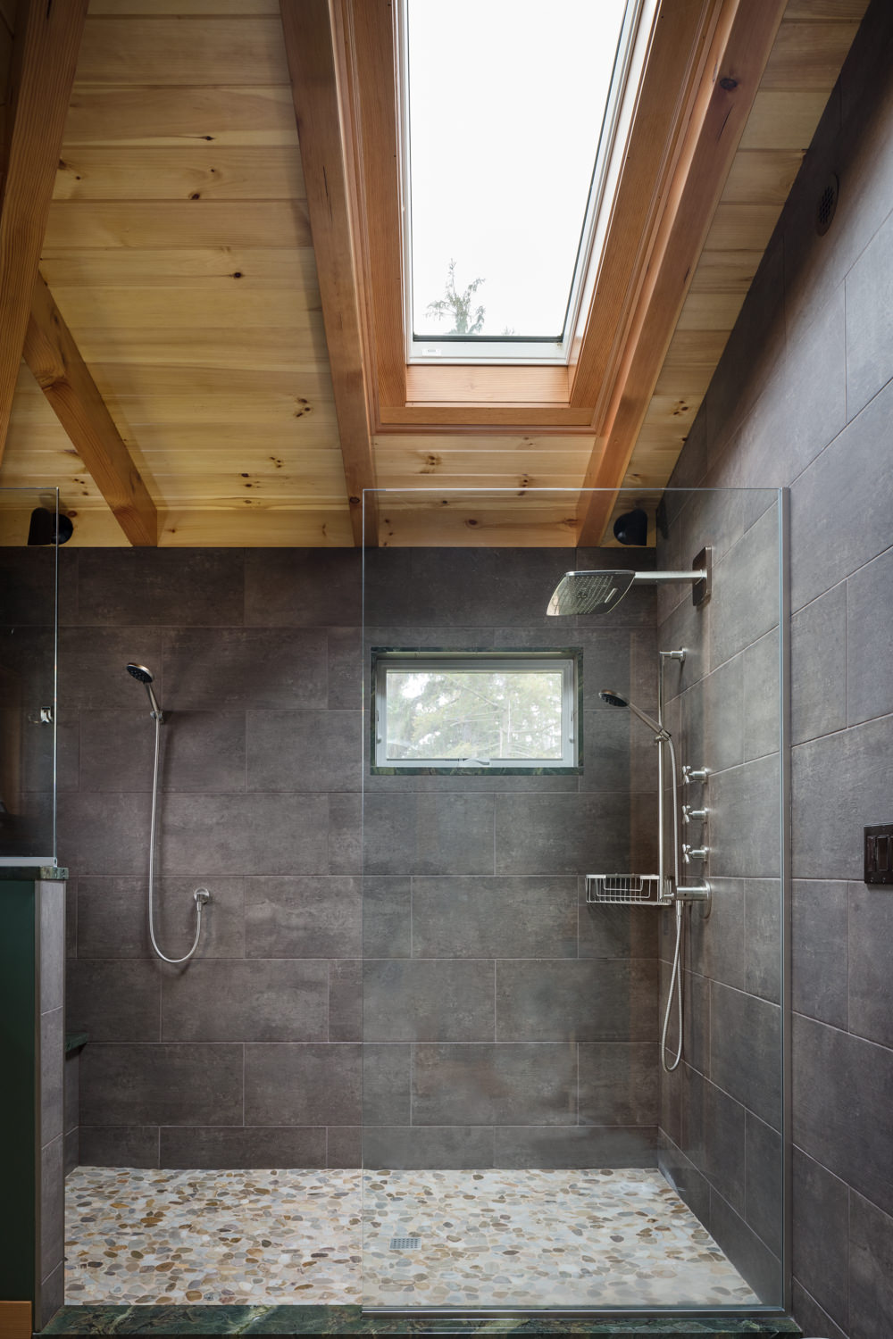 Interior architecture photo of a slate tiled walk-in shower in the master bath of a renovation by Wiemann Lamphere Architects and photographed by Vermont photographer Stina Booth of Studio SB.,