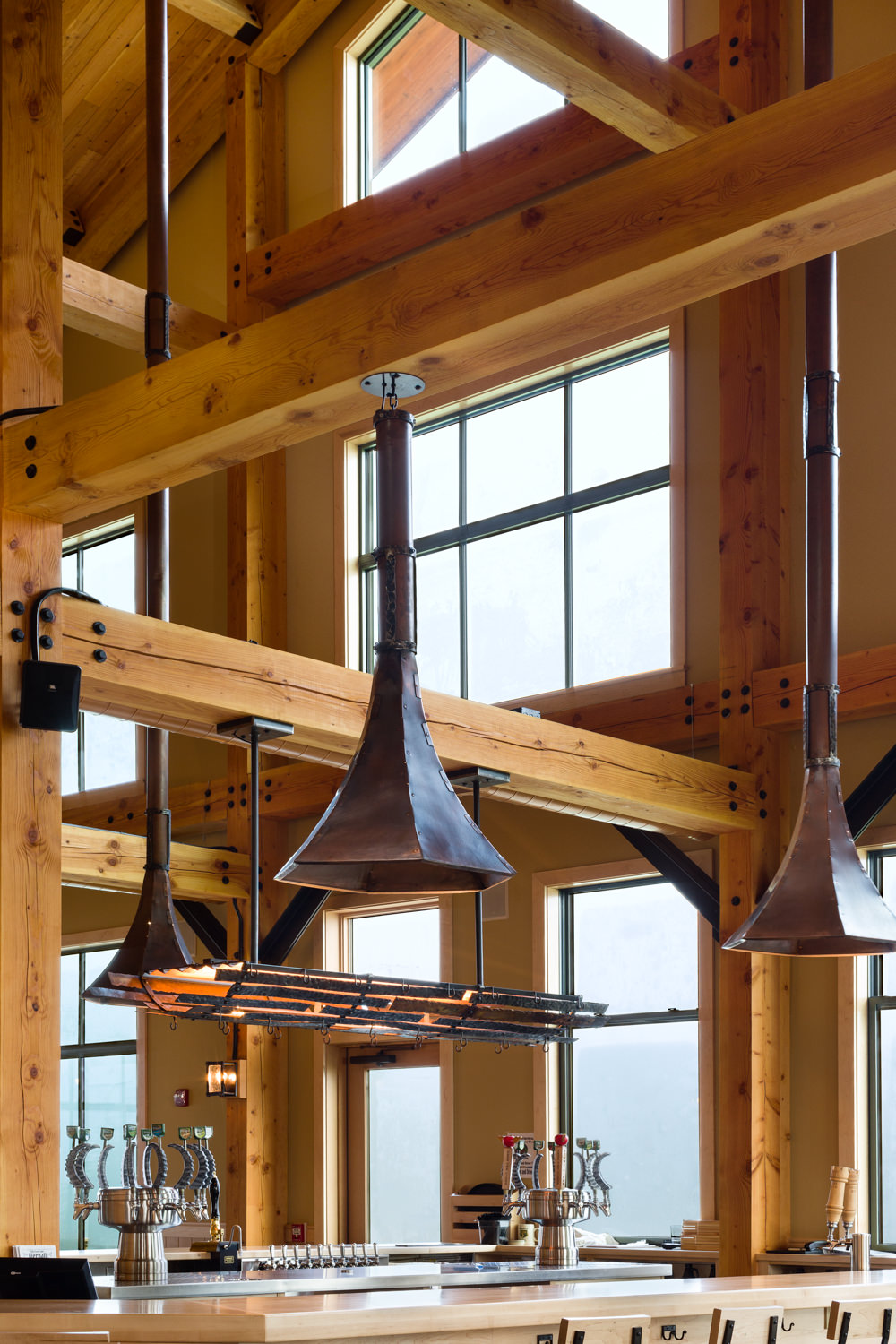 Interior photograph taken by Stina Booth of the Trapp Brewery Bierhall in Stowe Vermont designed by Guillot Vivian Viehmann Architects Inc. and constructed by Neagley & Chase Construction Co