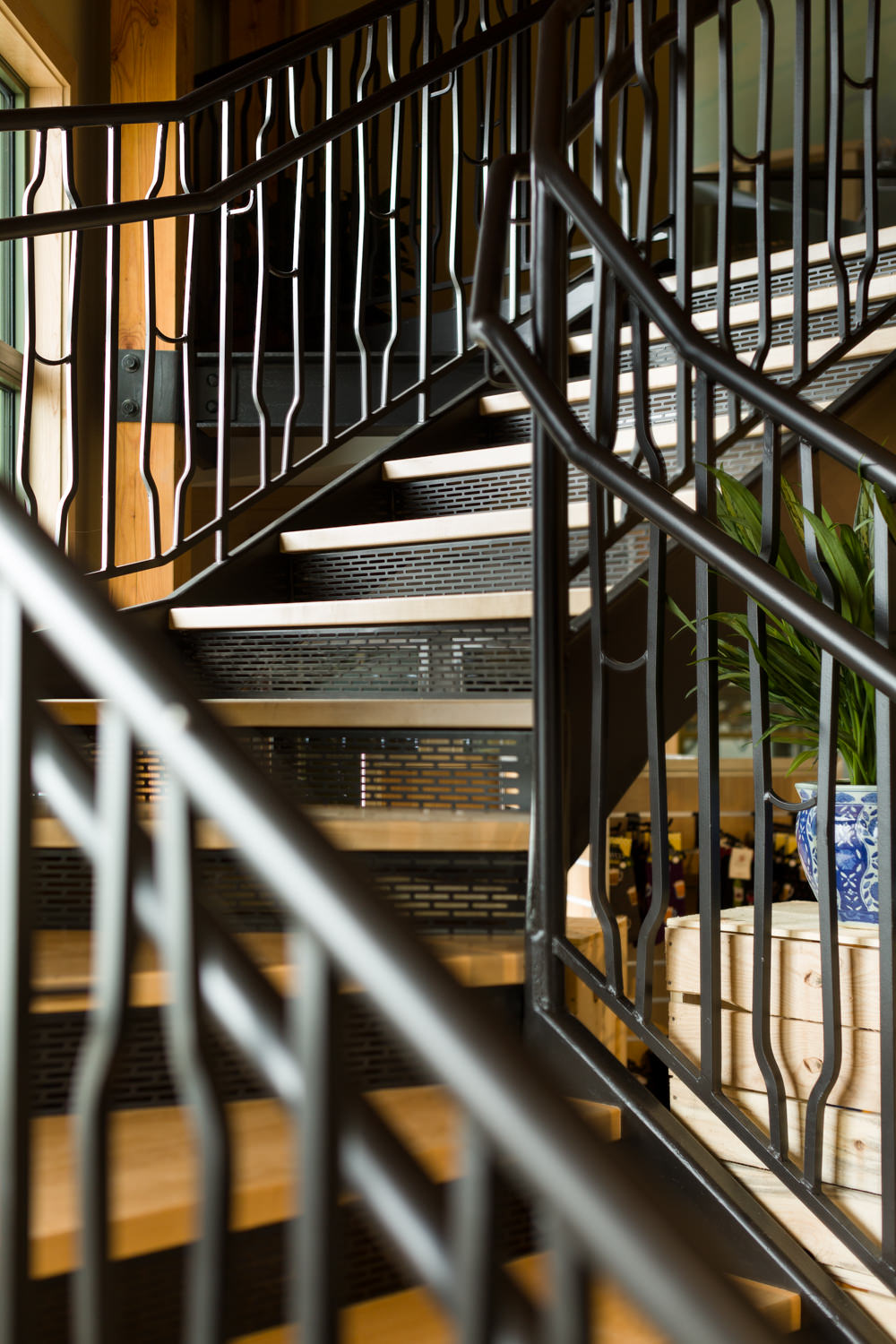 Detail photo taken by Stina Booth of the custom metal stair railing in the Trapp Brewery Bierhall in Stowe Vermont