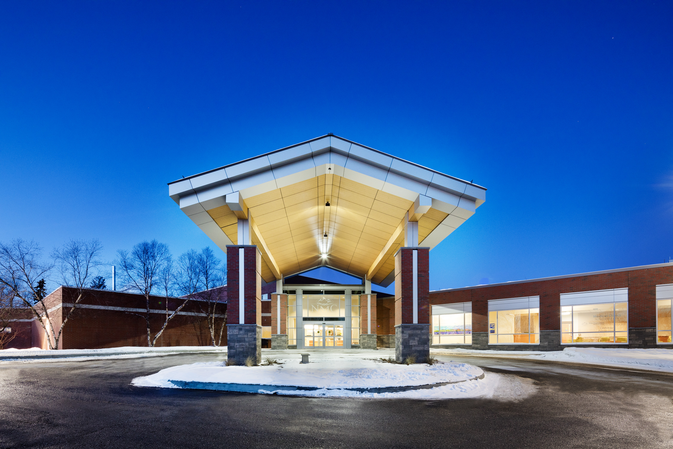 Exterior photo of the main entrance of Northwestern Medical Center in Saint Albans Vermont by commercial photographer Stina Booth