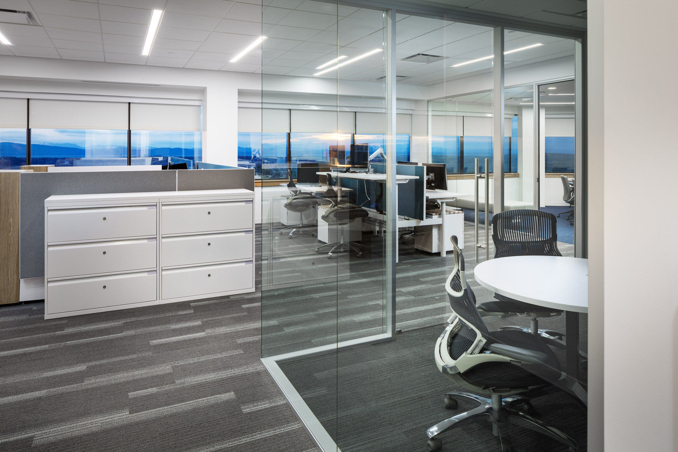A photo of the cubicle space and view of Lake Champlain in the modern office renovation for the Burlington Vermont office of KPMG by professional photographer Stina Booth