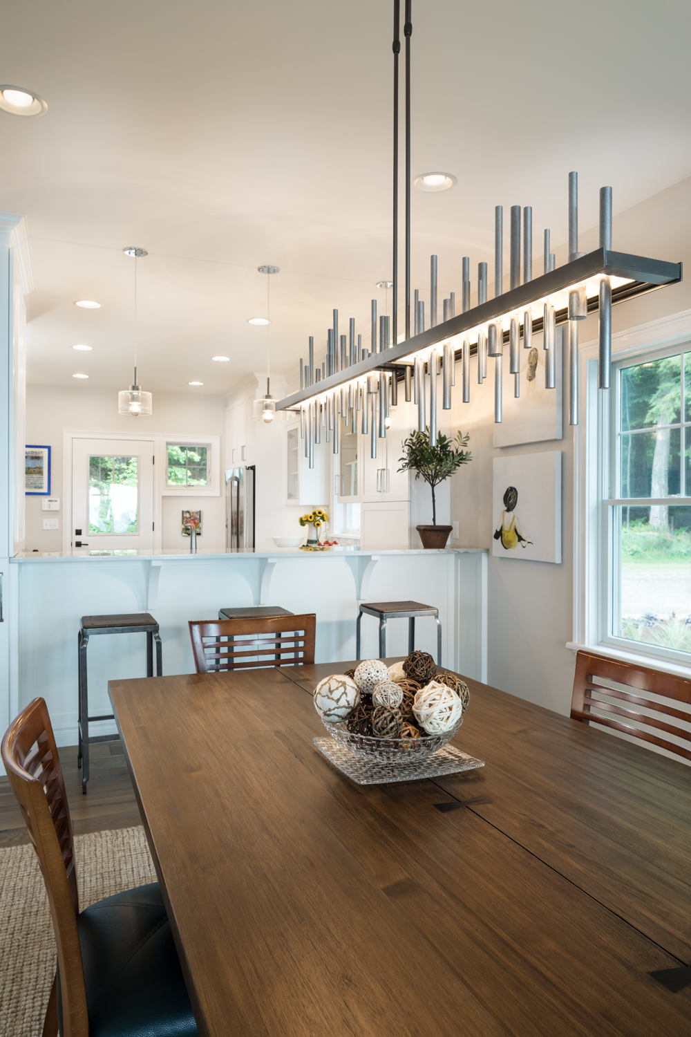A view of the open dining and kitchen area in a northern Vermont lake home taken by Vermont professional photographer Stina Booth