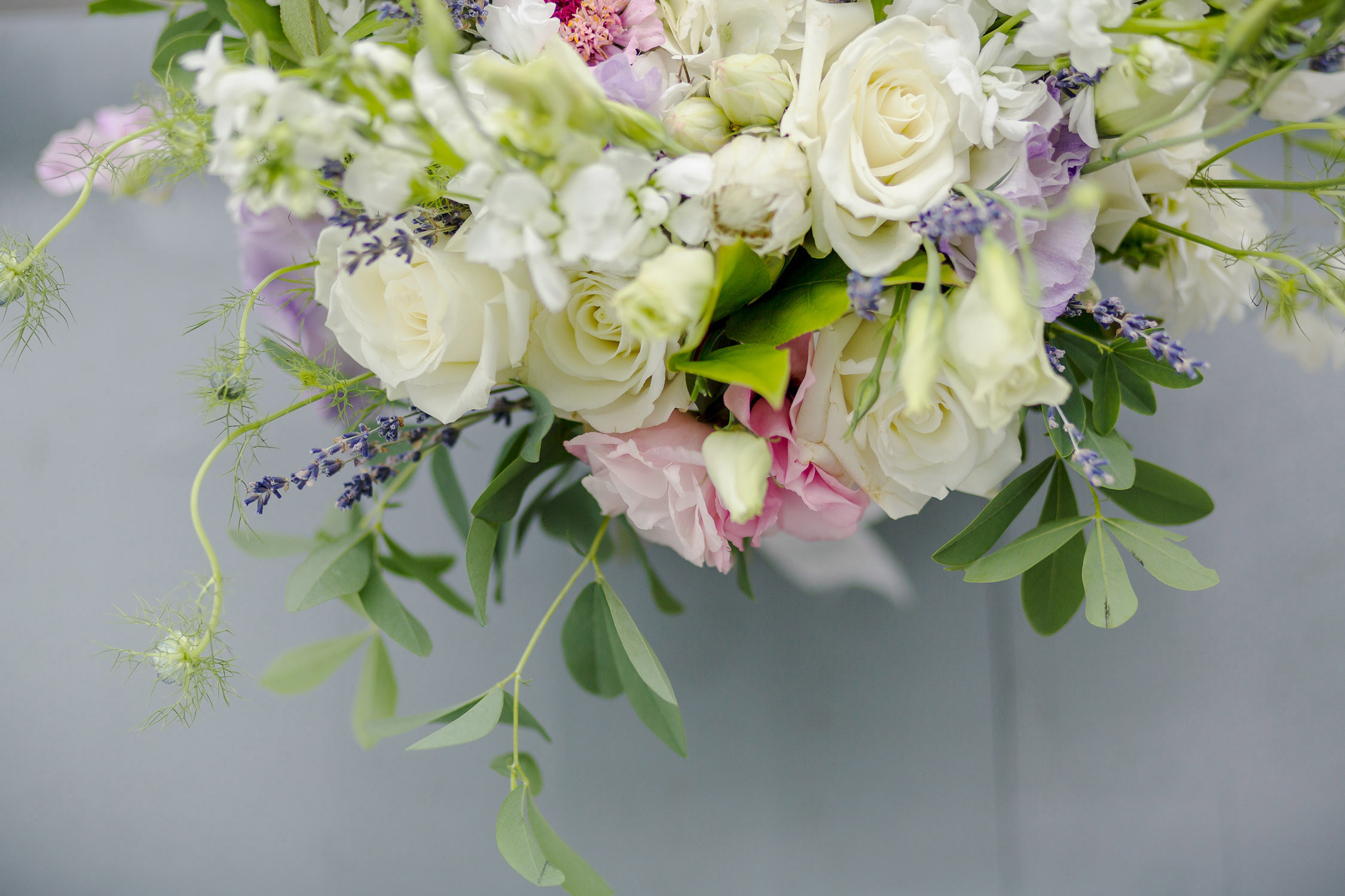 A pale pink and white wedding bouquet from threads and blooms