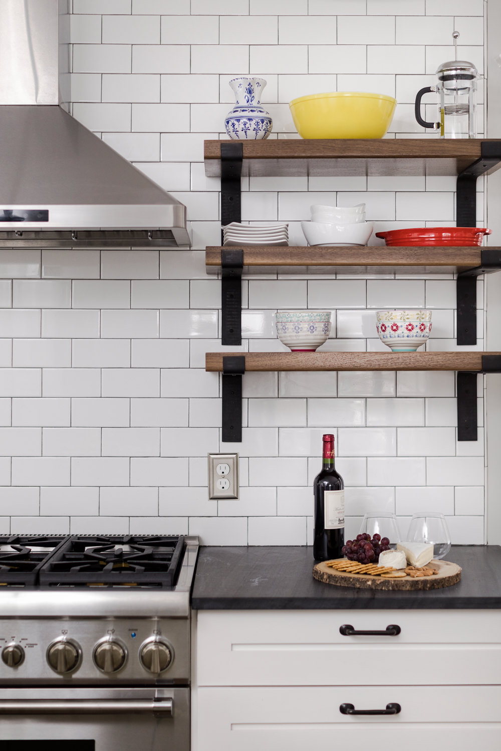 Photo of a white subway tiled kitchen taken by Stina Booth in Burlington Vermont