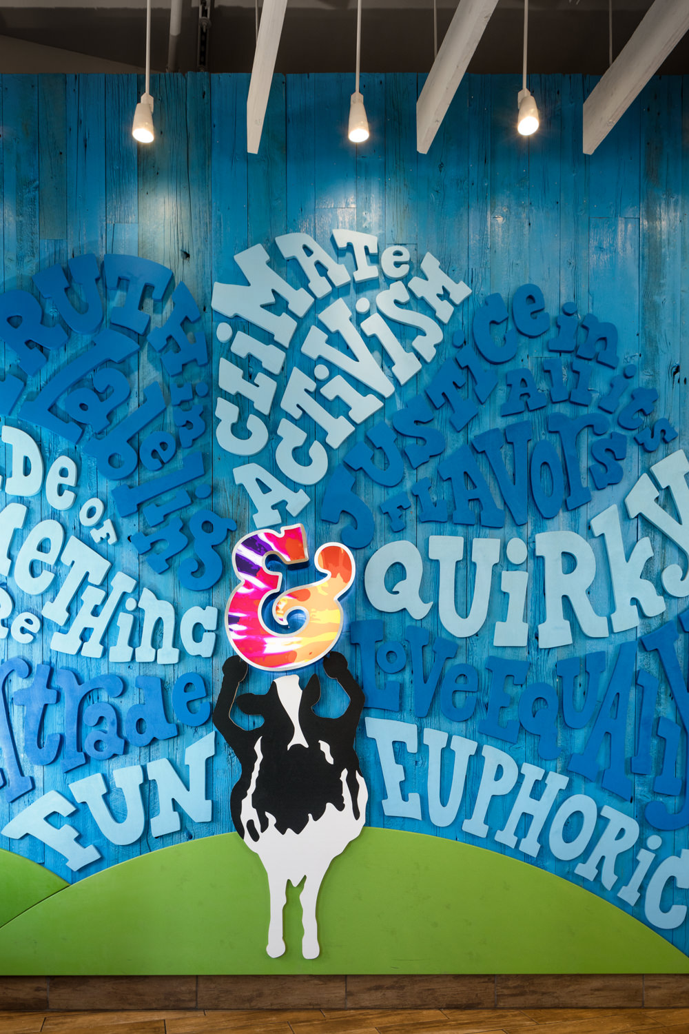 Photo of custom wall art in the 2017 renovation of the Ben & Jerry's scoop shop on Church Street in Burlington Vermont taken by photographer Stina Booth