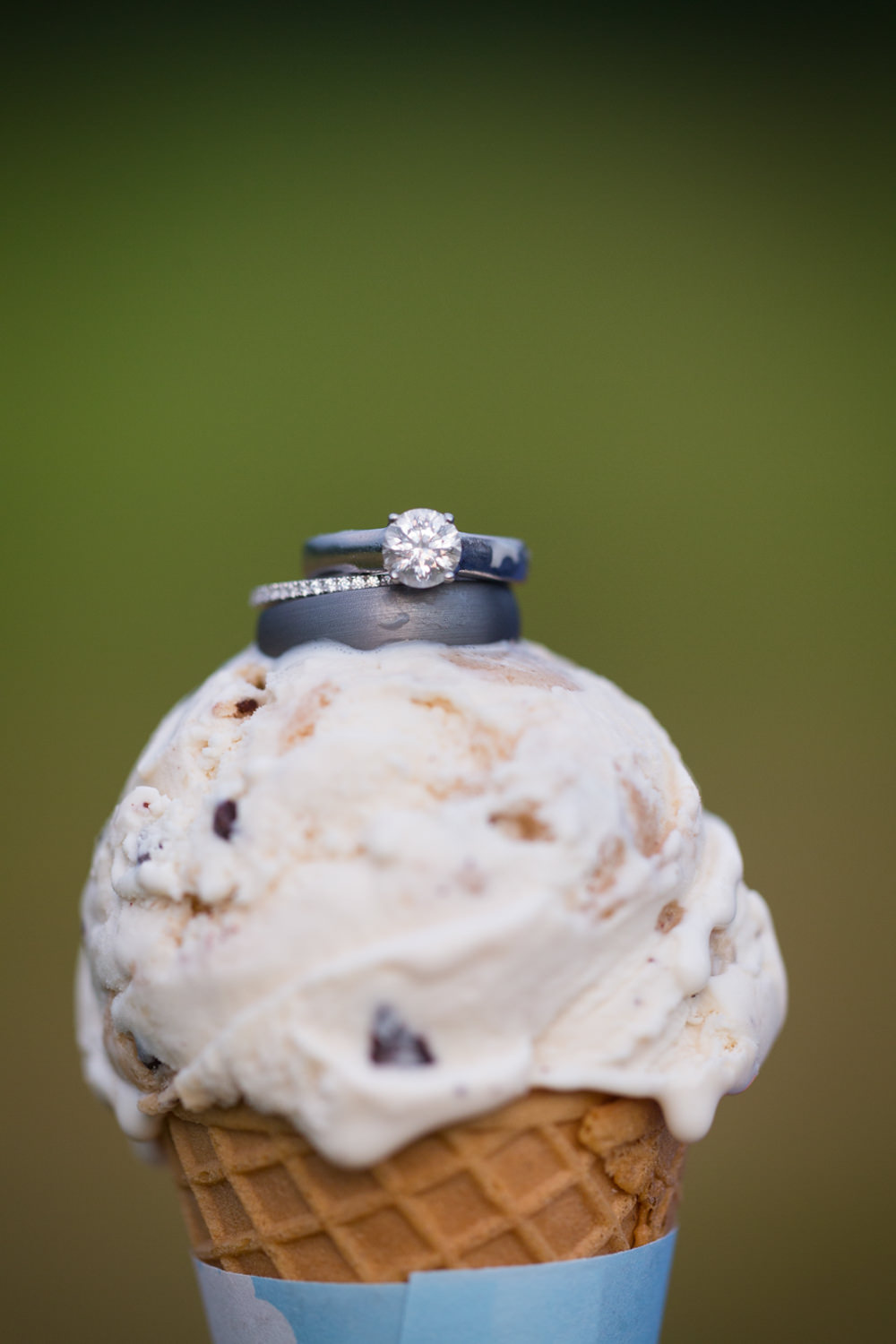 Wedding rings sit atop a Ben & Jerry's ice cream cone in a photo by food photographer Stina Booth