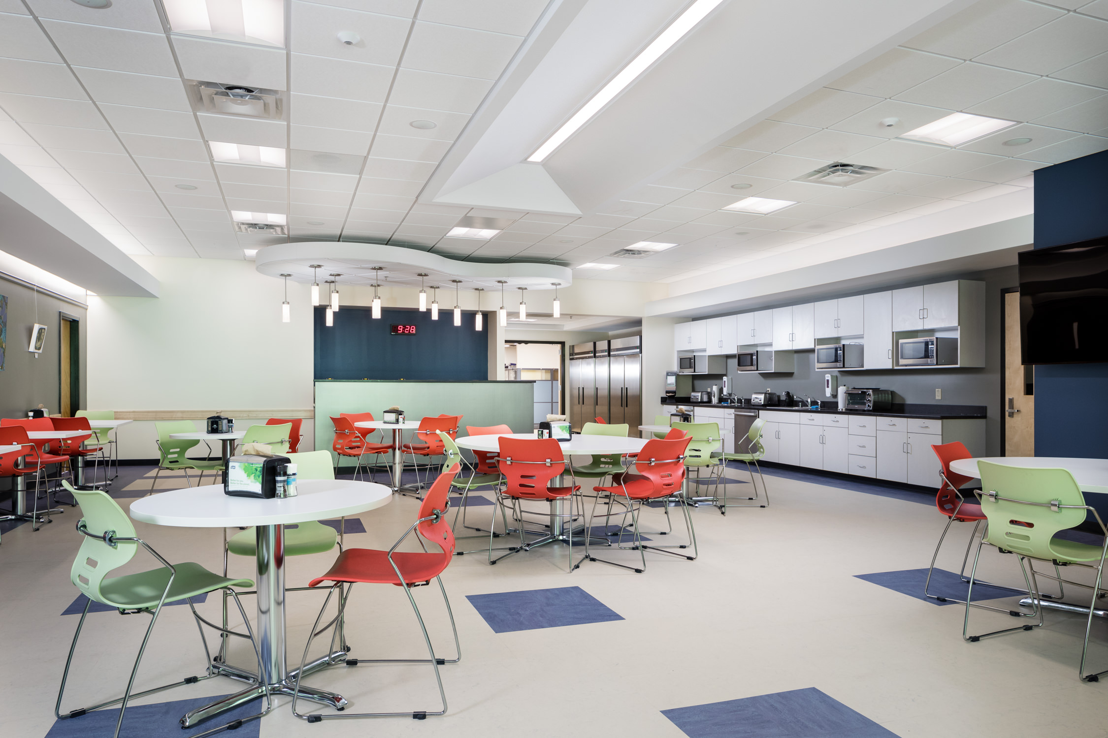 Photo by Stina Booth of the new modern cafeteria in the Biotek facility in Winooski Vermont constructed by Neagley & Chase Construction.
