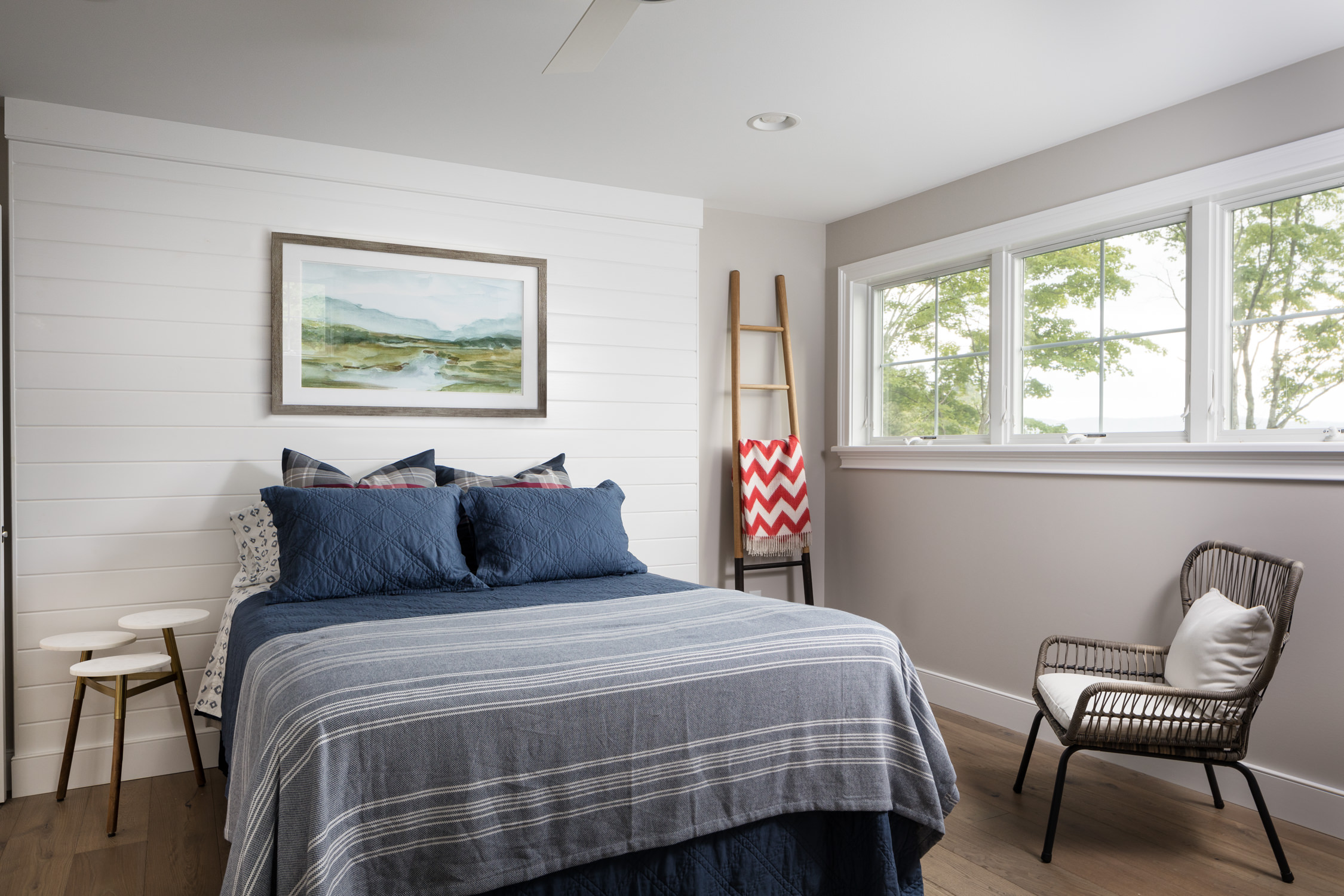 Photo of the rustic chic interior design of a casual guest bedroom in a northern Vermont lake home taken by Stina Booth