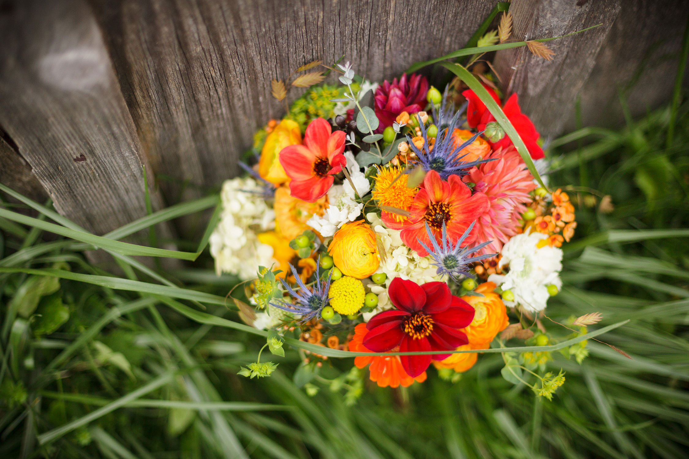 A bright red orange and yellow wedding bouquet