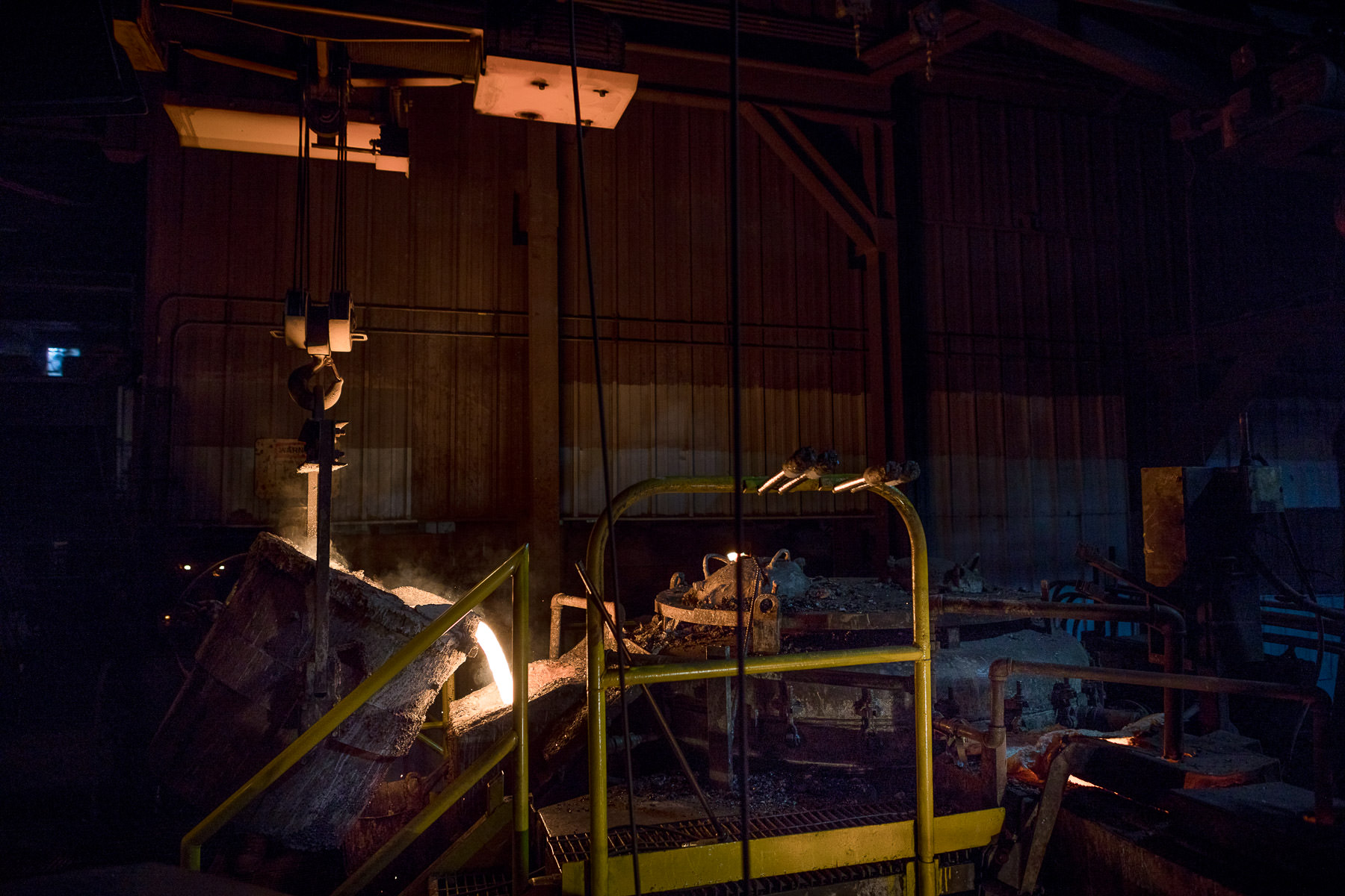 A photo of the iron pouring process at Vermont Castings in Randolph Vermont by professional photographer Stina Booth