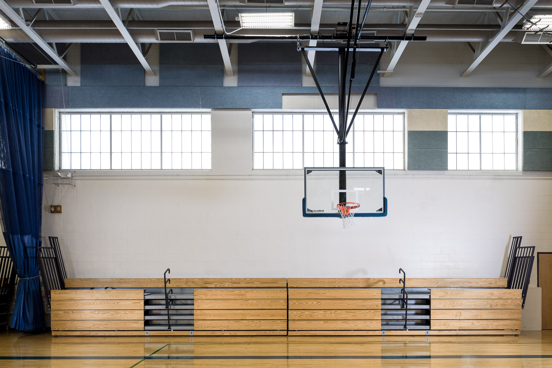 The renovated gymnasium at Vergennes Middle and High School in Vermont by Neagley & Chase Construction by commercial photographer Stina Booth