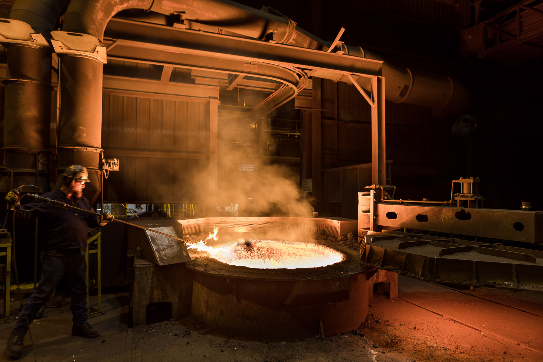 A photo of the iron pouring process at Vermont Castings in Randolph Vermont by professional photographer Stina Booth of