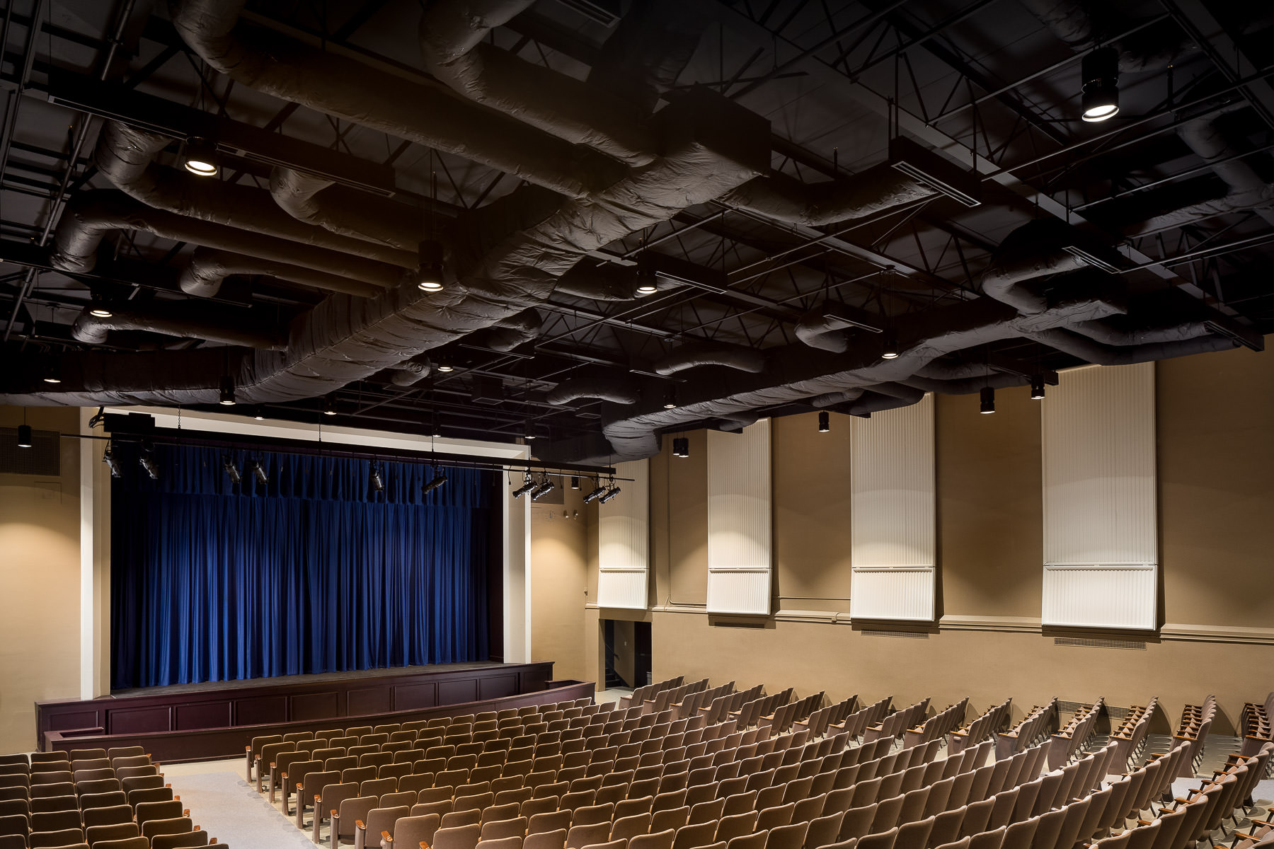 The renovated auditorium at Vergennes Middle and High School in Vermont by Neagley & Chase Construction by commercial photographer Stina Booth