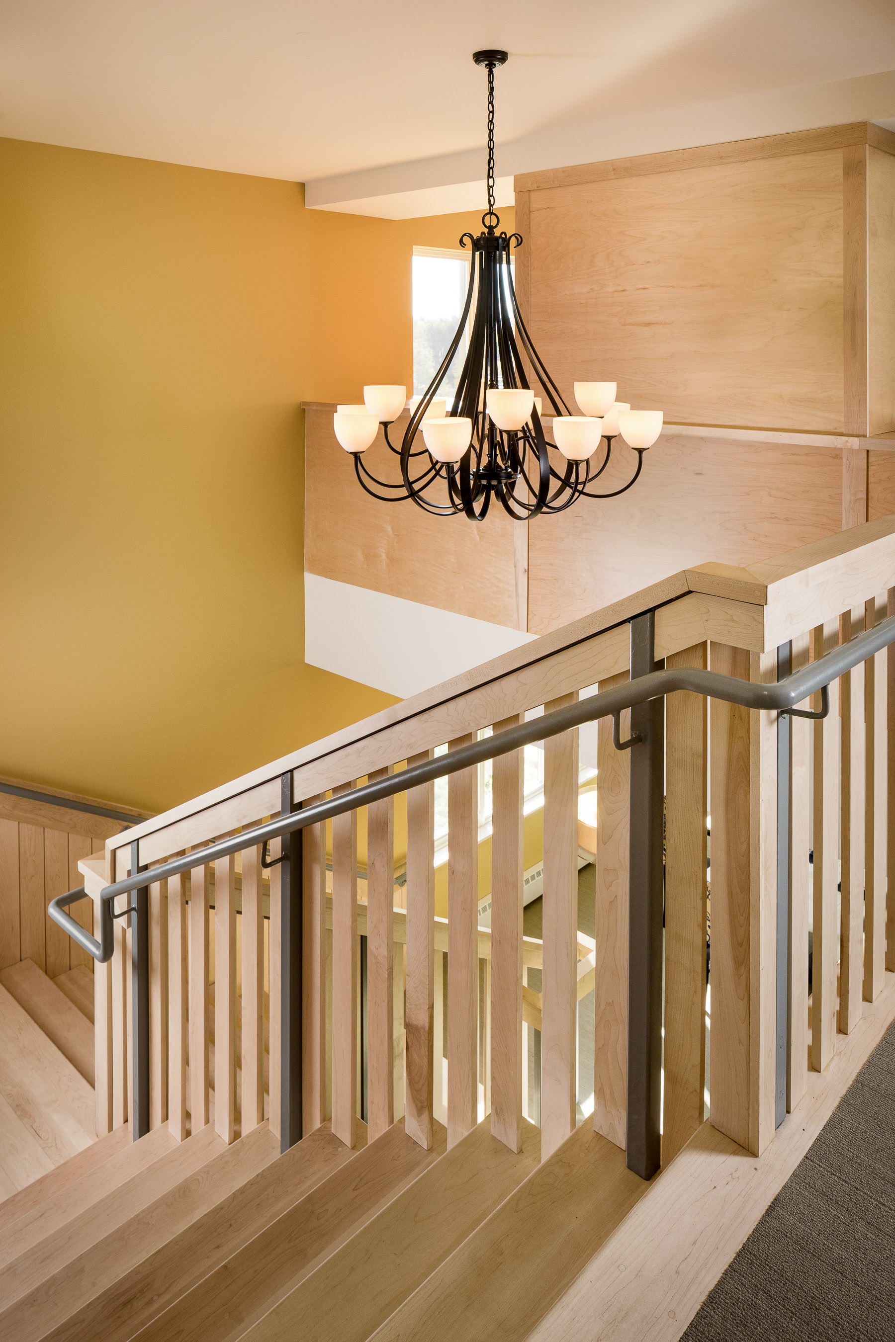 Architectural photo of the main floor stairwell in the Strode Independent Living Facility in Randolph by Vermont commercial photographer Stina Booth