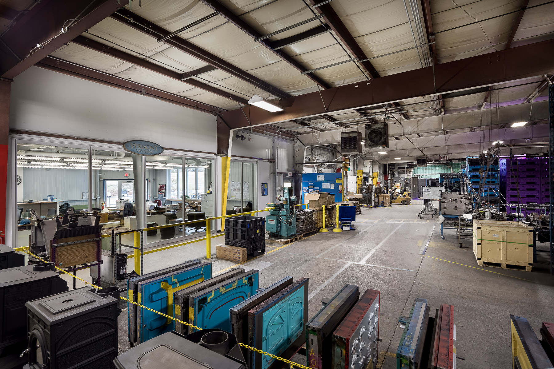 An interior photo of the renovated Vermont Castings manufacturing facility built by Neagley & Chase Construction and photographed by Stina Booth