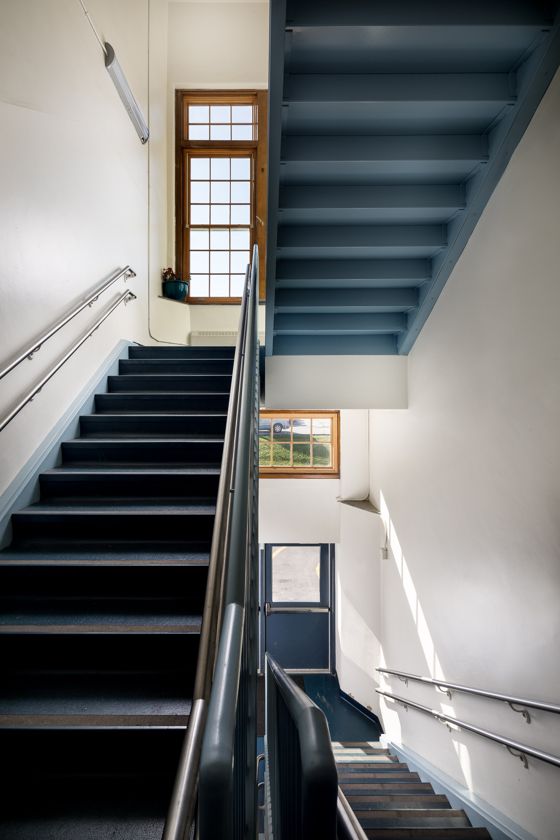 A renovated stairwell in Edmunds Elementary School in Burlington completed by Neagley & Chase Construction and photographed by Stina Booth Vermont commercial photography