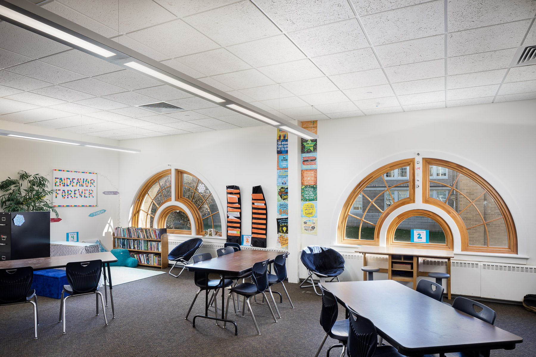 A renovated classroom featuring large arched windows in Edmunds Elementary School in Burlington completed by Neagley & Chase Construction and photographed by Stina Booth Vermont commercial photography