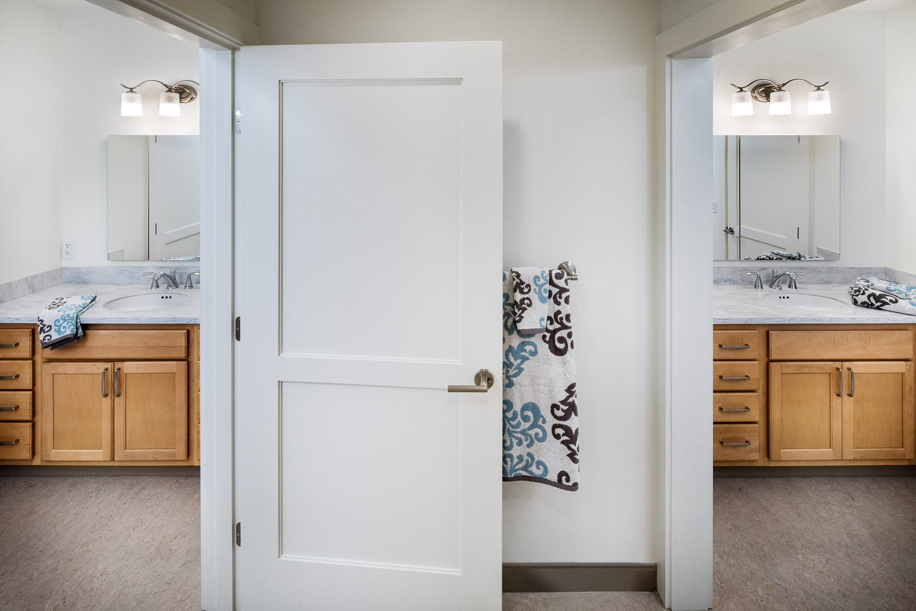 Architectural photo of a double bathroom in a double unit of the Strode Independent Living Facility in Randolph by Vermont commercial photographer Stina Booth