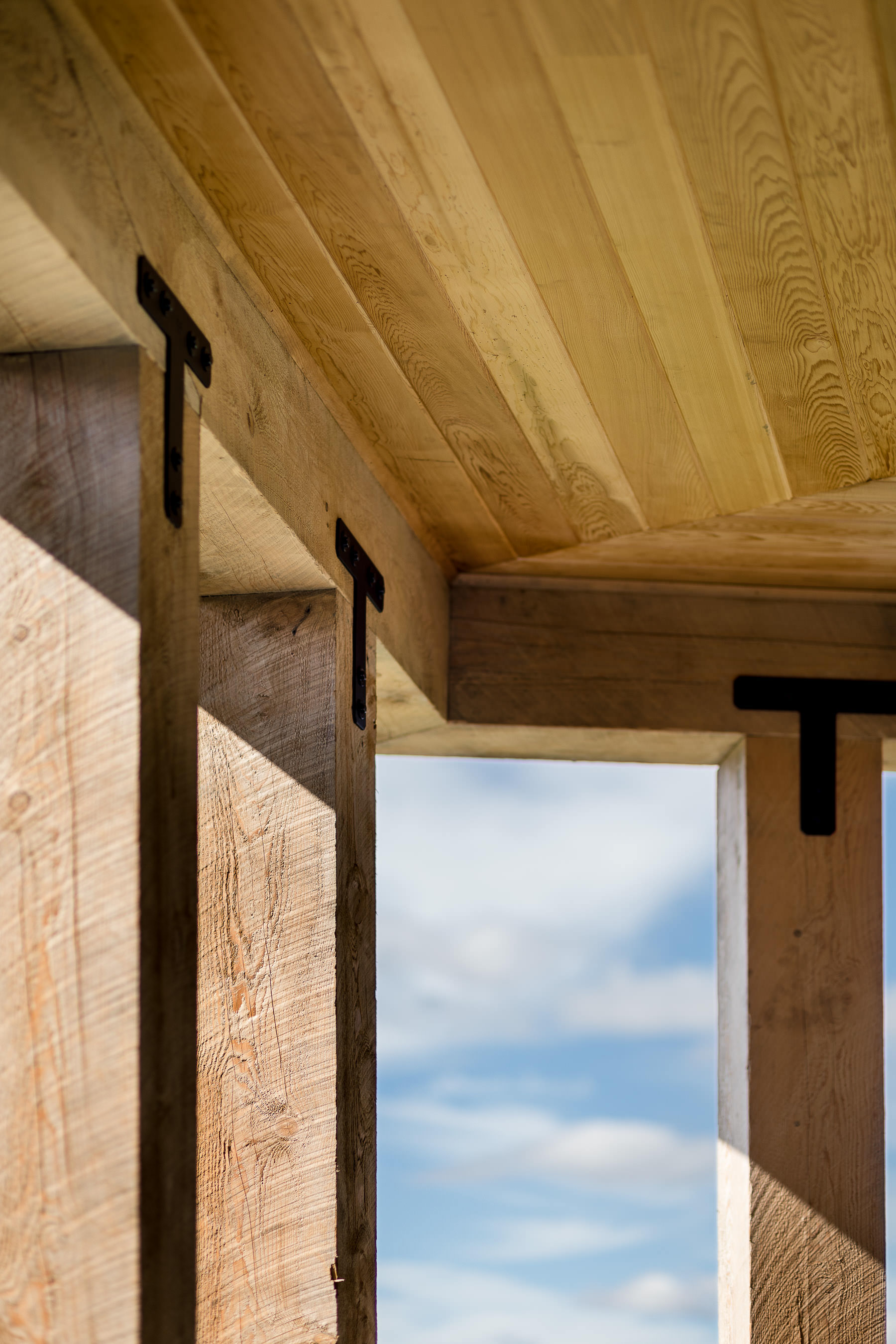 Detail photo of the porch timbers and metal brackets of the Strode Independent Living Facility in Randolph by Vermont commercial photographer Stina Booth