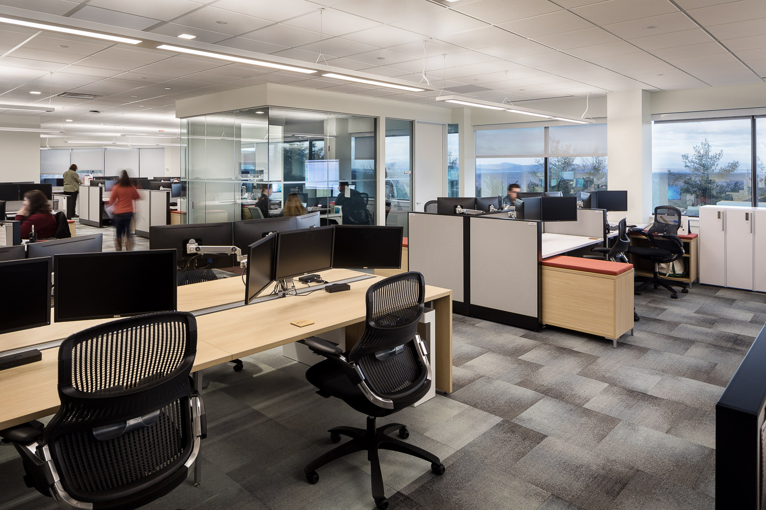 An open concept flex office space with workstations for employees at an insurance firm.